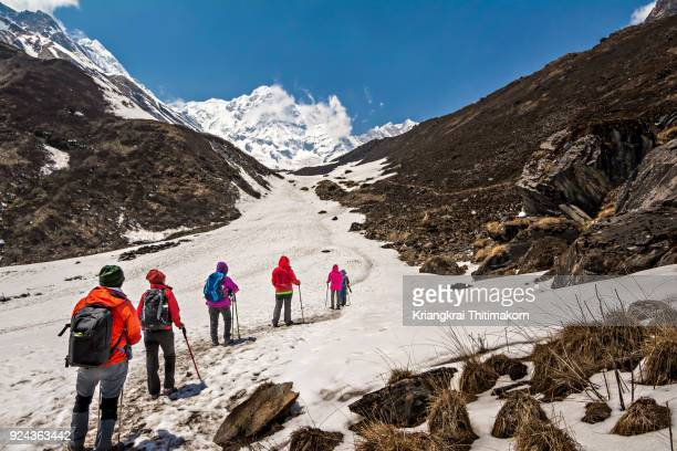 walking to annapurna base camp, nepal. - base camp stock pictures, royalty-free photos & images