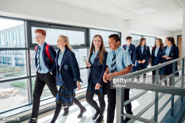 walking to class - school children stock pictures, royalty-free photos & images
