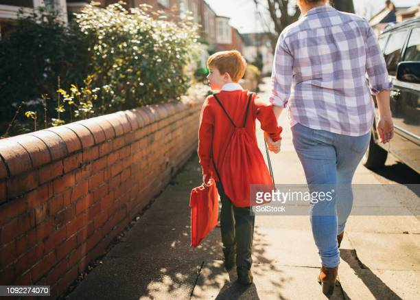walking to school - education stock pictures, royalty-free photos & images