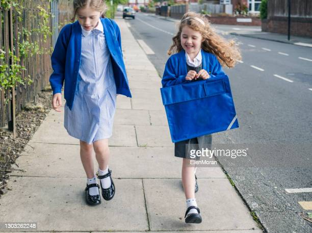 walking to school - school child stock pictures, royalty-free photos & images