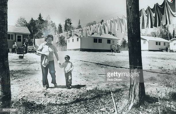 Walking to Shore of Winnipeg river in Minaki town 40 miles northwest of Kenora Norma Brant and her son Danny 3 enjoy spring sun Mrs Brant an Indian...