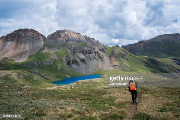 walking to stunning ice lake - tundra stock pictures, royalty-free photos & images