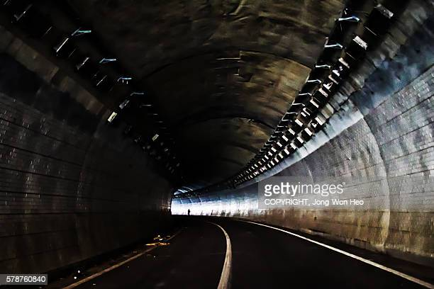 walking to the light at the end of the tunnel - 最後 ストックフォトと画像