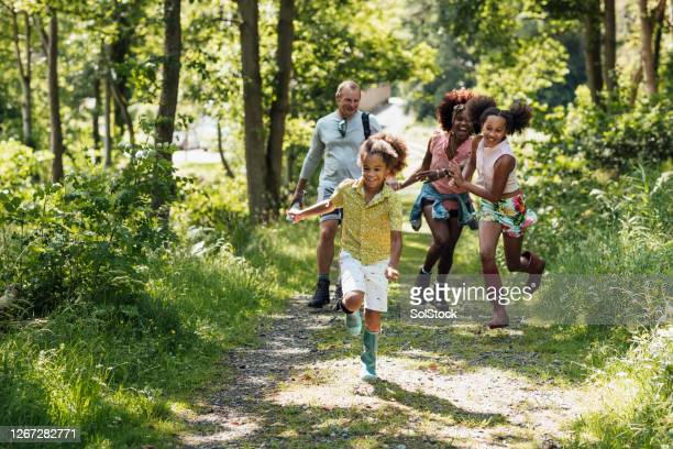 walking together as a family - walking stock pictures, royalty-free photos & images