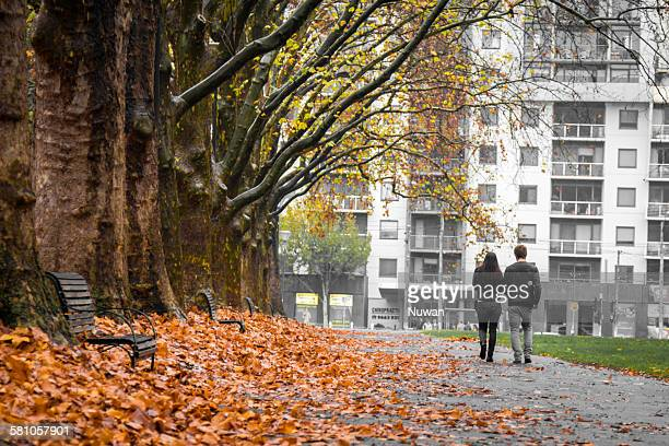 walking together - carlton gardens stock pictures, royalty-free photos & images