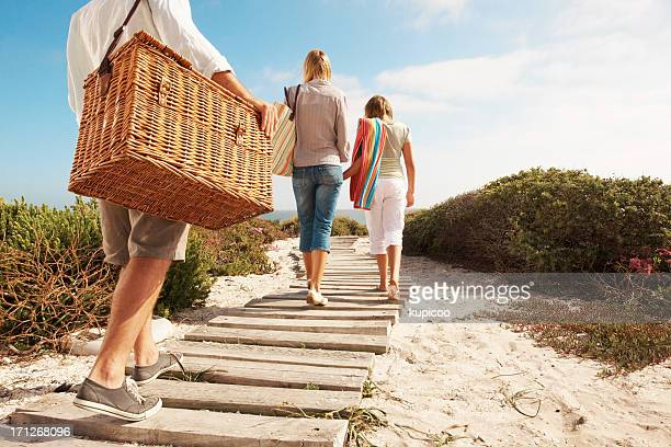 walking towards a great picnic spot - picnic basket stock pictures, royalty-free photos & images