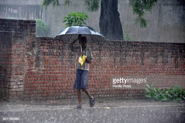 Walking under an umbrella in the rain It is expected that the monsoon rain will hit the region starting in July and lasting till September yearly
