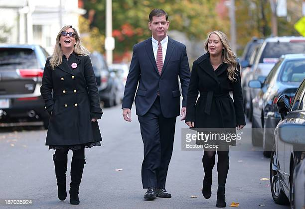 Walking up to the location to vote Rep Marty Walsh voted with his partner Lorrie Higgins left and her daughter Lauren Campbell at the Cristo Rey...