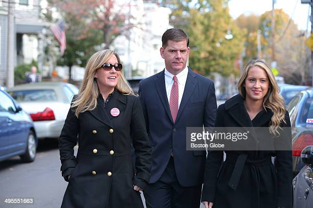 Walking up to vote Rep Marty Walsh voted with his partner Lorrie Higgins left and her daughter Lauren Campbell at the Cristo Rey School 100 Savin...