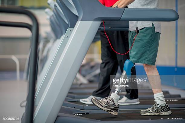 walking with a prosthetic leg - artificial limb stock photos and pictures