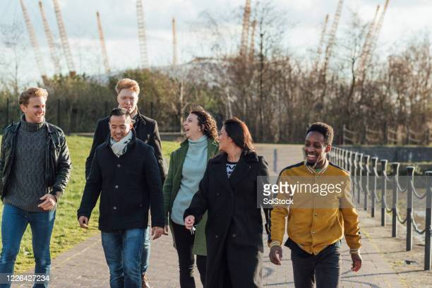 walking with friends - cultures stock pictures, royalty-free photos & images