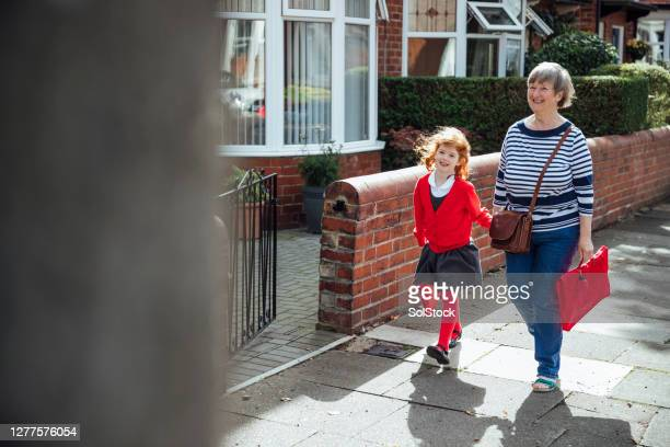 walking with grandma - walking stock pictures, royalty-free photos & images