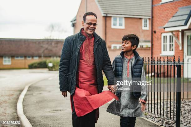 walking with his grandson - south asia stock pictures, royalty-free photos & images
