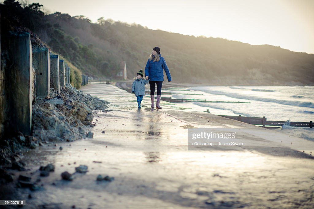 Walking with mum at Totland bay : Stock Photo