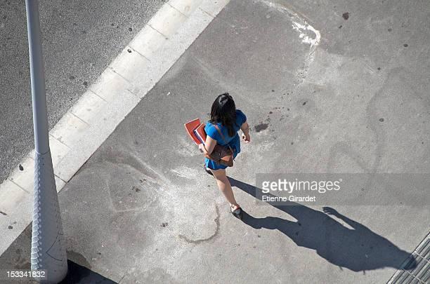 Walking woman carrying files