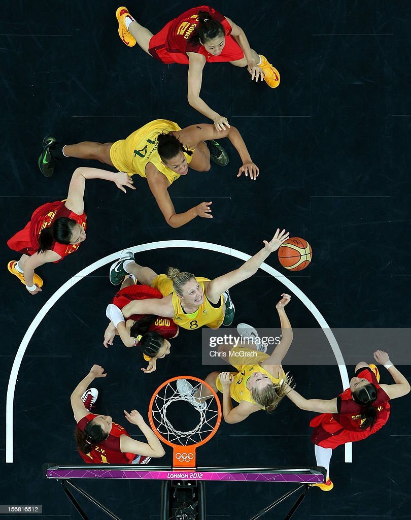 Walkley Press Photographer of The Year Portfolio and Sport Category Finalist on November 22, 2012 in Singapore. Image Caption: Suzy Batkovic #8 of Australia reaches for a rebound against China during the Women's Basketball quaterfinal on Day 11 of the London 2012 Olympic Games at the Basketball Arena on August 7, 2012 in London, England.