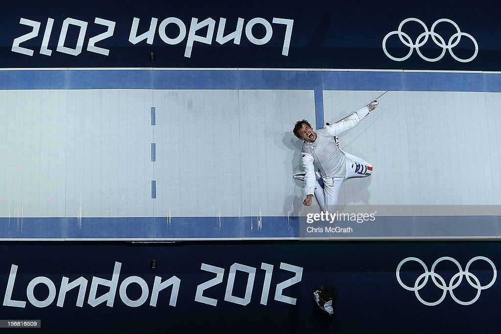 Walkley Sport Category Finalist - London 2012 - An Overview, set of 5 images on November 22, 2012 in Singapore. Image Caption: Andrea Baldini of Italy celebrates defeating Yuki Ota of Japan to win the gold medal match 45-39 in the Men's Foil Team Fencing finals on Day 9 of the London 2012 Olympic Games at ExCeL on August 5, 2012 in London, England.