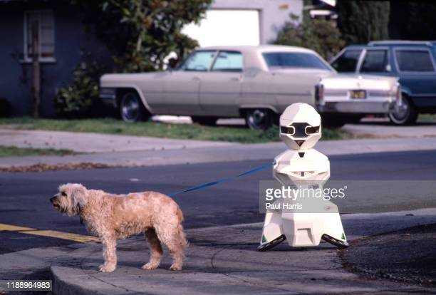 TOPO walks a dog The Robot was built by Androbot Inc a company owned by Nolan Bushnell he founded Atari in 1972 and is known as one of the founding...