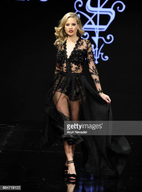 A walks the runway wearing Adolfo Sanchez at Art Hearts Fashion LAFW Fall/Winter 2017 Day 4 at The Beverly Hilton Hotel on March 17 2017 in Beverly...