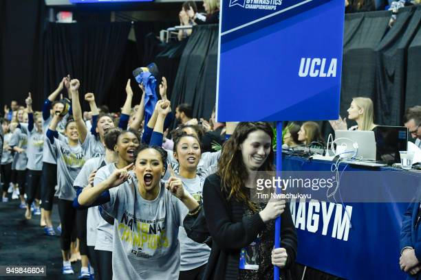 UCLA walks to the podium during the Division I Women's Gymnastics Championship held at Chaifetz Arena on April 21 2018 in St Louis Missouri UCLA won...