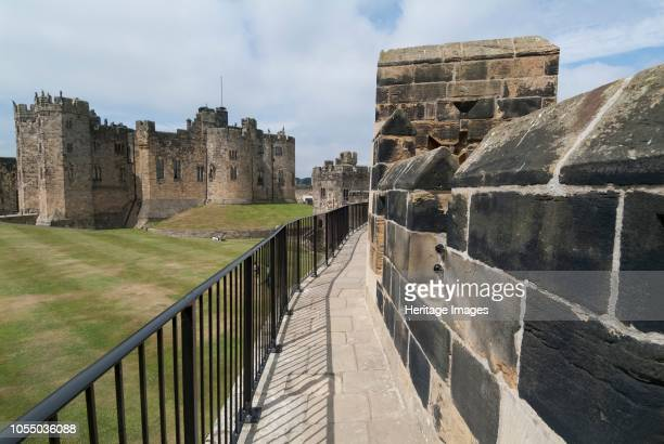 Walkway along the walls of Alnwick Castle originally dating from the 12th century now the home of the Duke of Northumberland and the second largest...