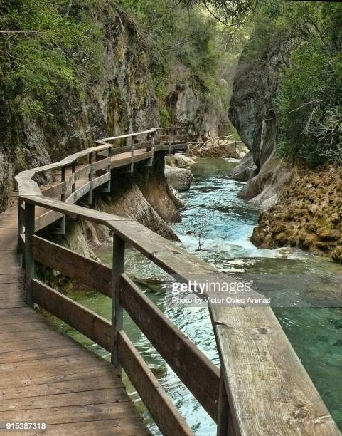 Walkway alongside river Borosa at the Cerrada de Elías, a narrow, rocky ravine with cold, crystal-clear pools