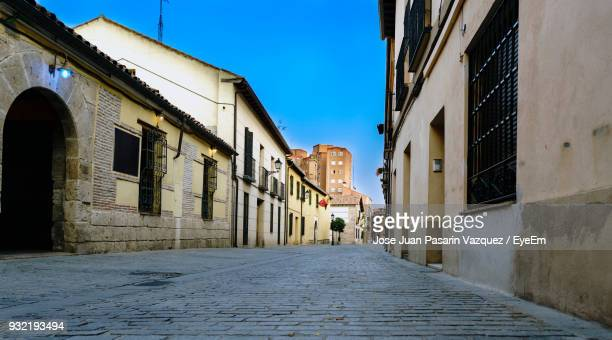walkway amidst buildings in city - alcala de henares stock pictures, royalty-free photos & images