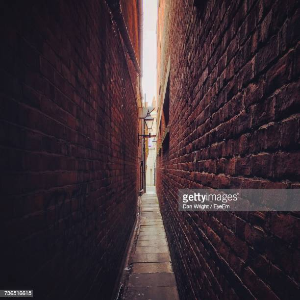 walkway amidst buildings - narrow stock pictures, royalty-free photos & images