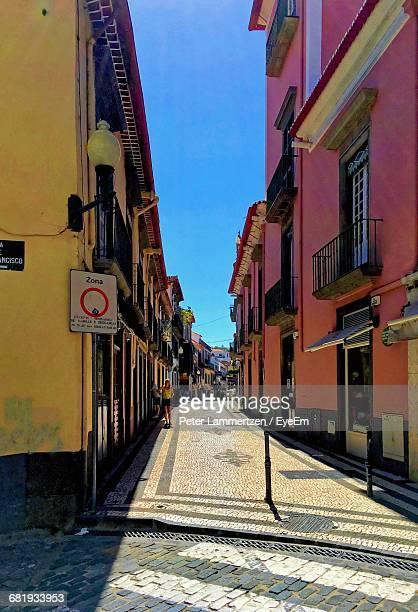walkway amidst residential buildings - funchal stock pictures, royalty-free photos & images