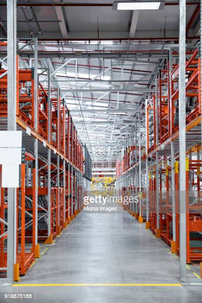 walkway amidst shelves at automobile industry - spare part stock pictures, royalty-free photos & images