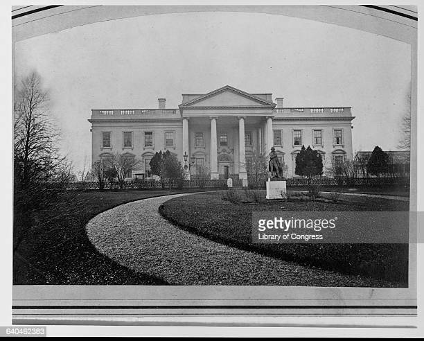 A walkway and statue in front of the White House in Washington D C ca 1860