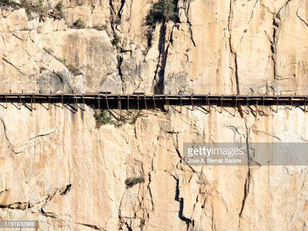 walkway and wooden bridges pinned along the steep walls of a narrow gorge in the nature. - elevated walkway stock pictures, royalty-free photos & images