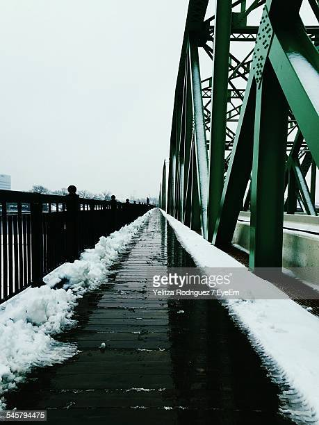 walkway by bridge against clear sky during winter - trenton bridge stock photos and pictures