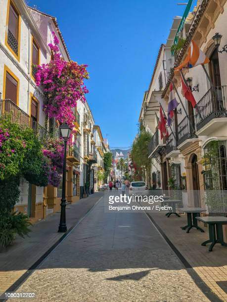 walkway by road in city against clear sky - marbella stock pictures, royalty-free photos & images