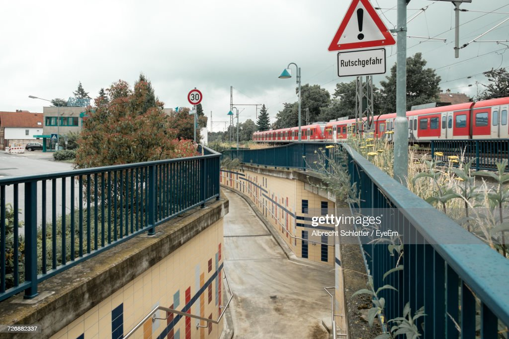 Walkway By Train In City Against Sky : Stock Photo