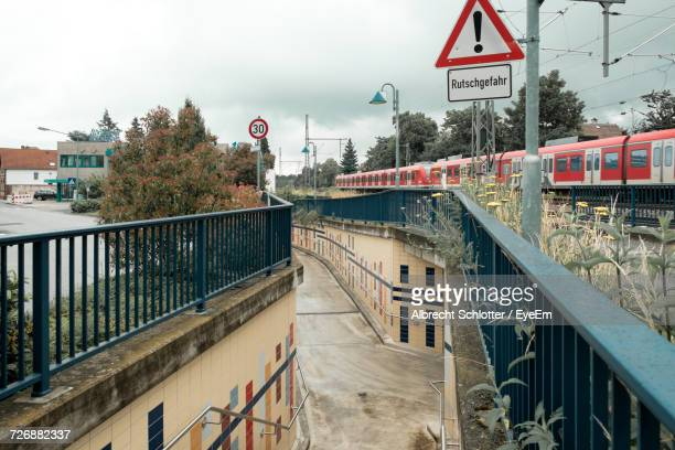 walkway by train in city against sky - albrecht schlotter stock photos and pictures