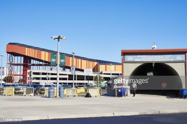 A walkway for MetLife Stadium stands in front of the ramp for the American Dream complex indoor ski slope in East Rutherford New Jersey US on...