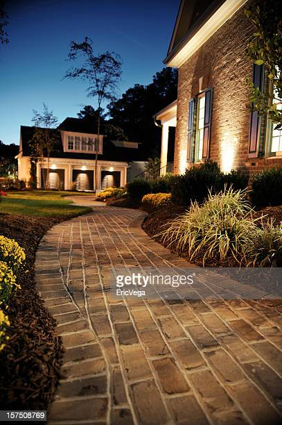 walkway in front of luxury home - pedestrian walkway stock pictures, royalty-free photos & images