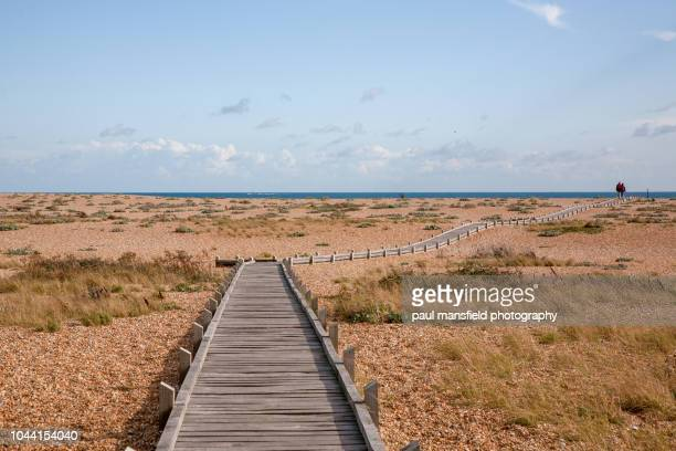 walkway leading to sea - kent county stock pictures, royalty-free photos & images