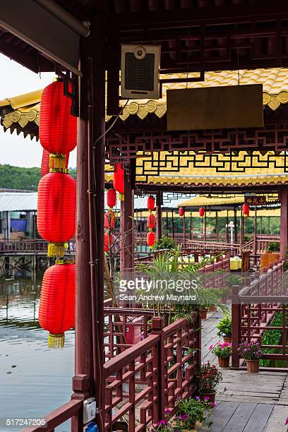 walkway of a chinese restaurant built on a pond - wuhan city stock photos and pictures