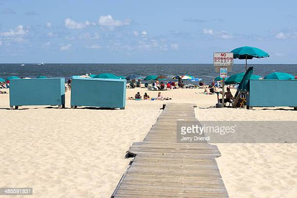 a walkway on the ocean city beach. - ocean city maryland stock pictures, royalty-free photos & images