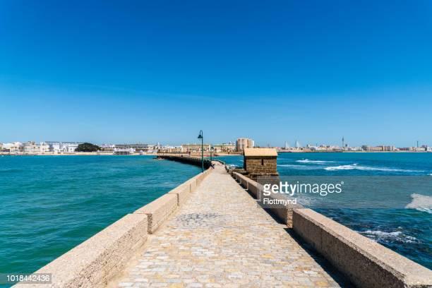 Walkway Paseo Fernando Quiñones towards the castle in Cadiz, Spain