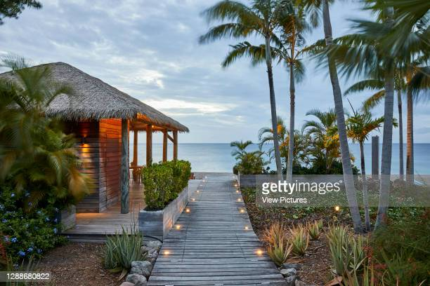 Walkway to beach. Paradise Beach Nevis, St Thomas' Parish, Saint Kitts and Nevis. Architect: Naomi Cleaver, 2019.