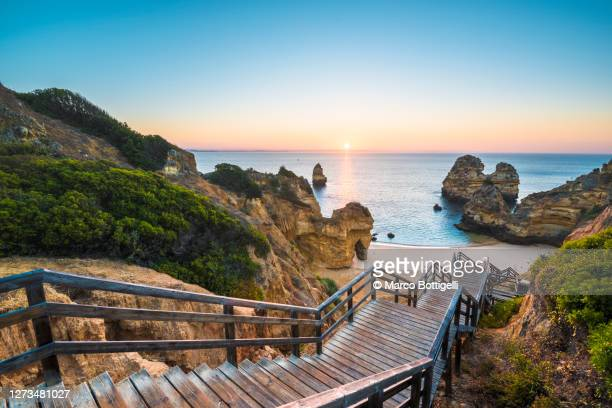 walkway to idyllic beach, algarve, portugal - portugal stock pictures, royalty-free photos & images