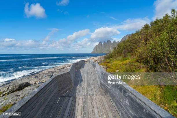 walkway to view the devils teeth, okshornan range, tungeneset coastline, senja island, troms county, norway - peter adams stock pictures, royalty-free photos & images