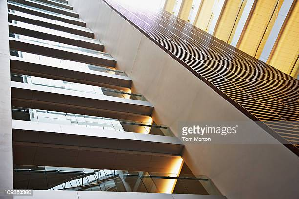 walkways in modern office building - building atrium stock pictures, royalty-free photos & images