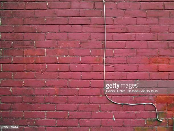Wall and cable painted in red