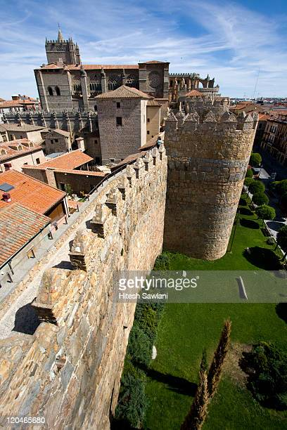 wall and cathedral - avila stock photos and pictures