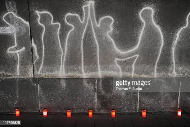 Wall art and candles are pictured in the tunnel of the 2010 Loveparade disaster near to where many of the deaths occurred on the first anniversary of...