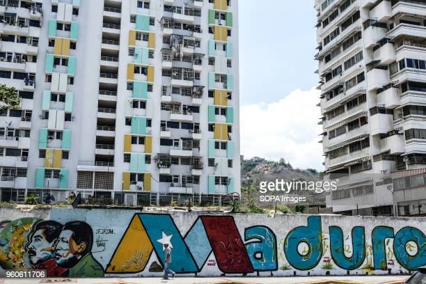 A wall art featuring the president Maduro and the ex president Chavez seen in a local residential area The presidential elections called by the...